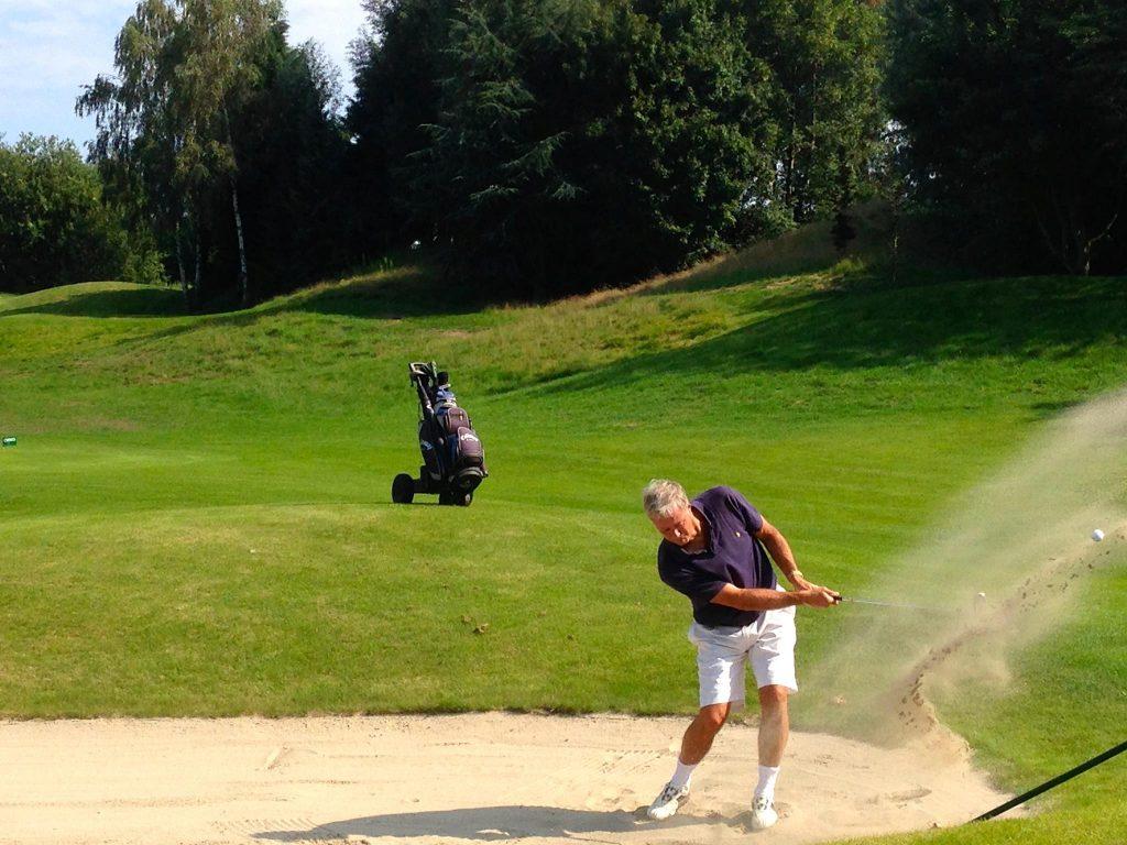 ball striking golf swing bunker 2
